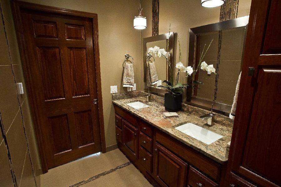 Bathroom Design, double sink vanity, raised panel vanity doors, cherry cabinetry, bathroom pendant above sink, white kohler sinks