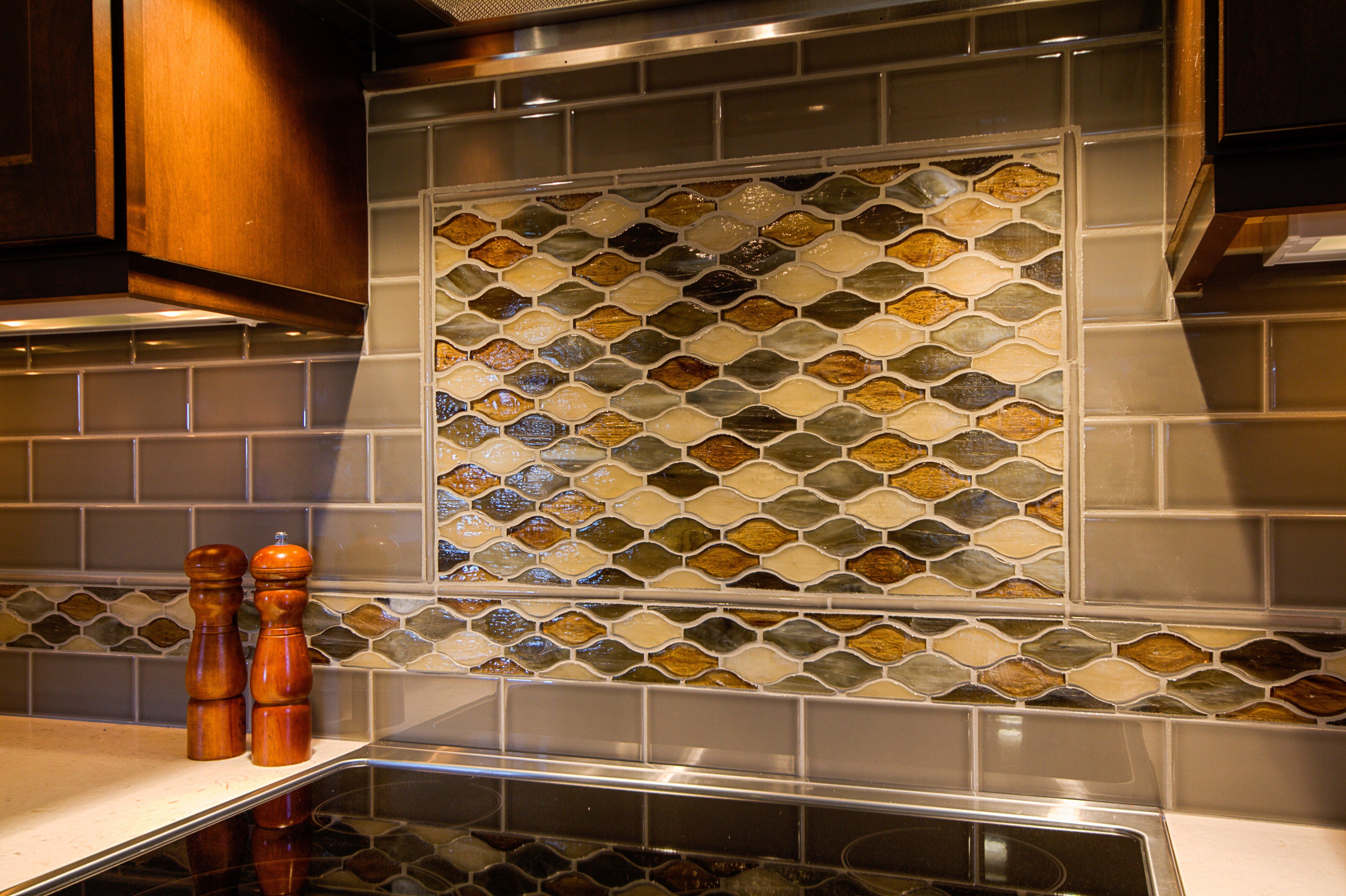 Kitchen Remodeling and Design, glazzio tile, tile medallion above the stove, brown and grey backsplash