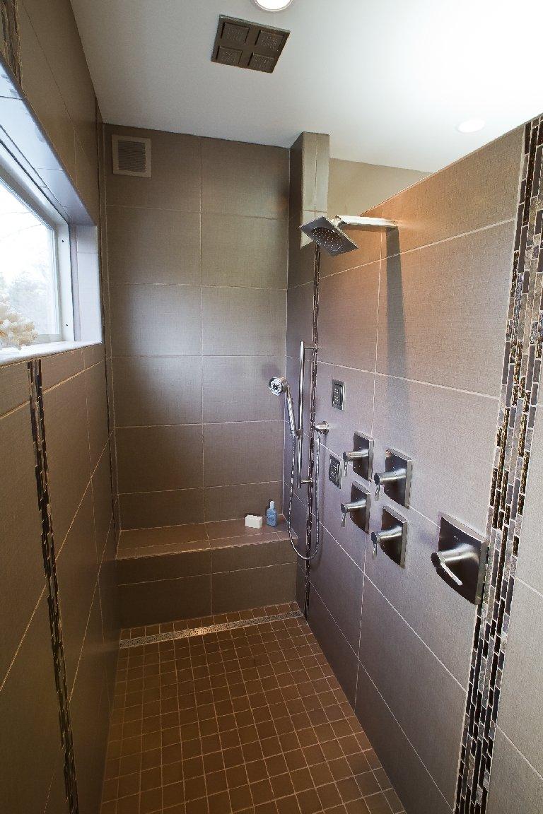 Bathroom Design, custom walk-in shower, built-in shower bench, vertical accent tile, 2x2 shower floor tile, ceiling shower rain head, shower body sprays, shower window