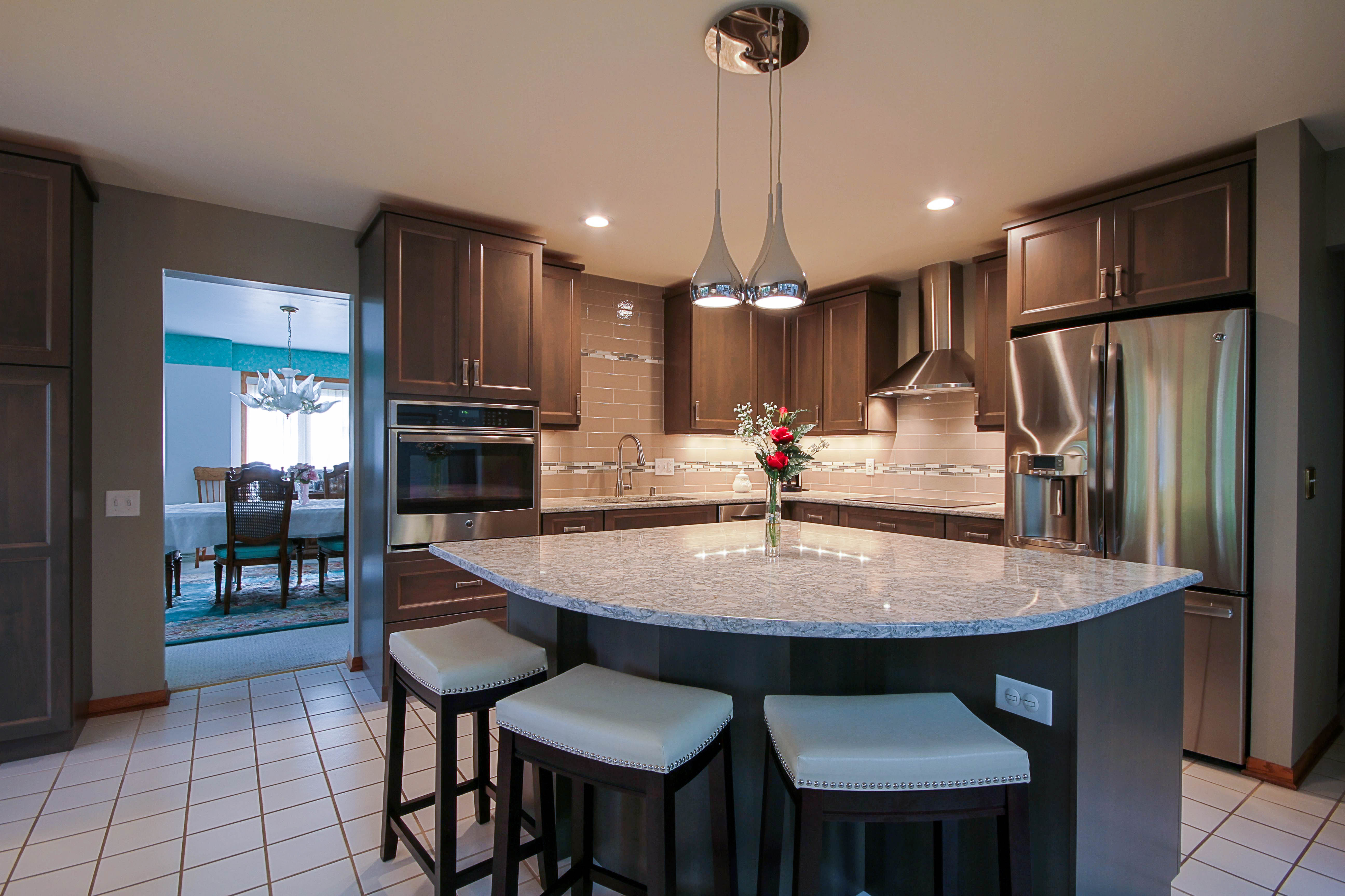 Kitchen Remodeling, pie shape kitchen island, kitchen pendant, white kitchen stools, grey cabinets