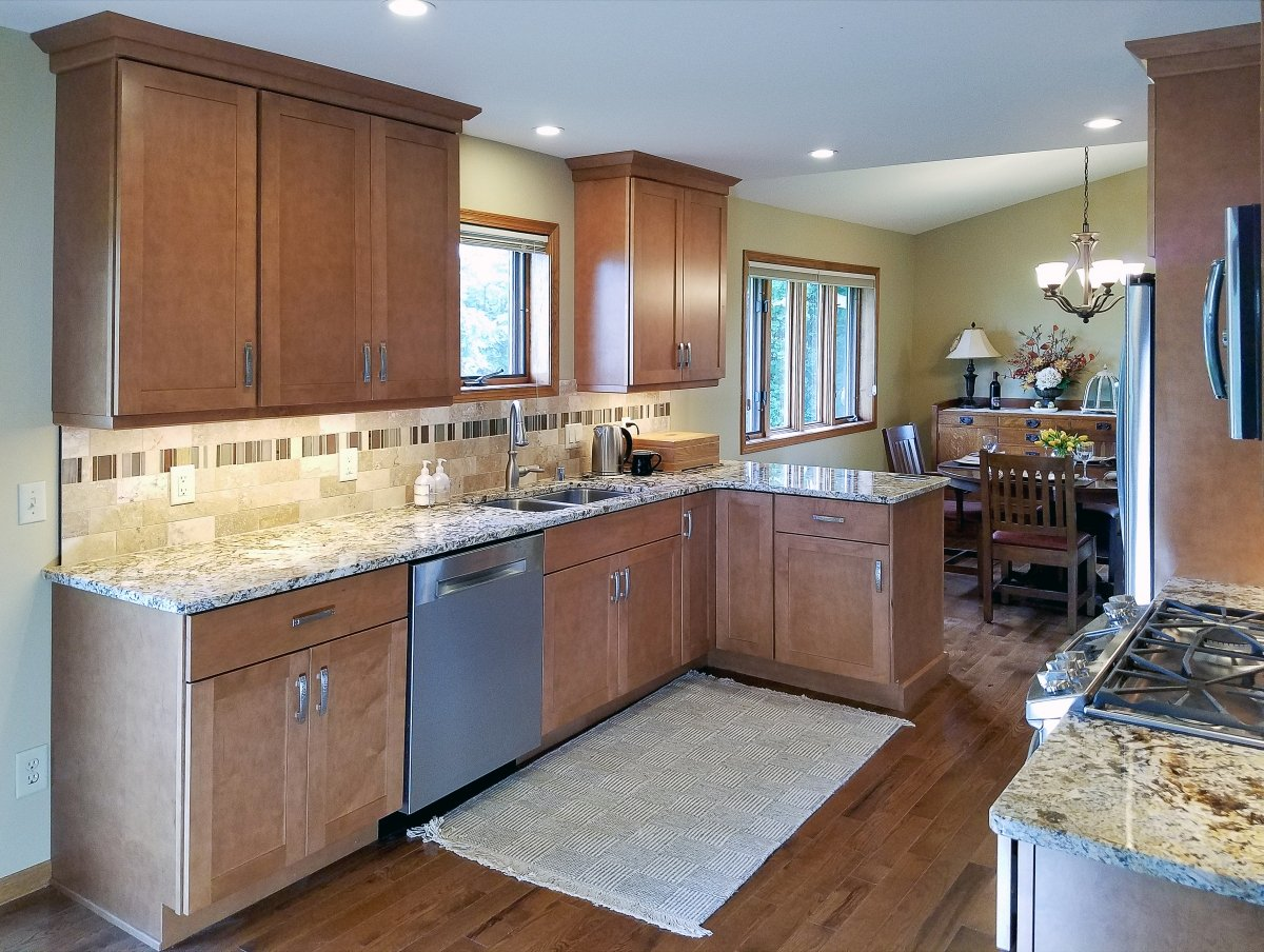Kitchen Remodeling, small kitchen peninsula, granite countertop, travertine subway tile