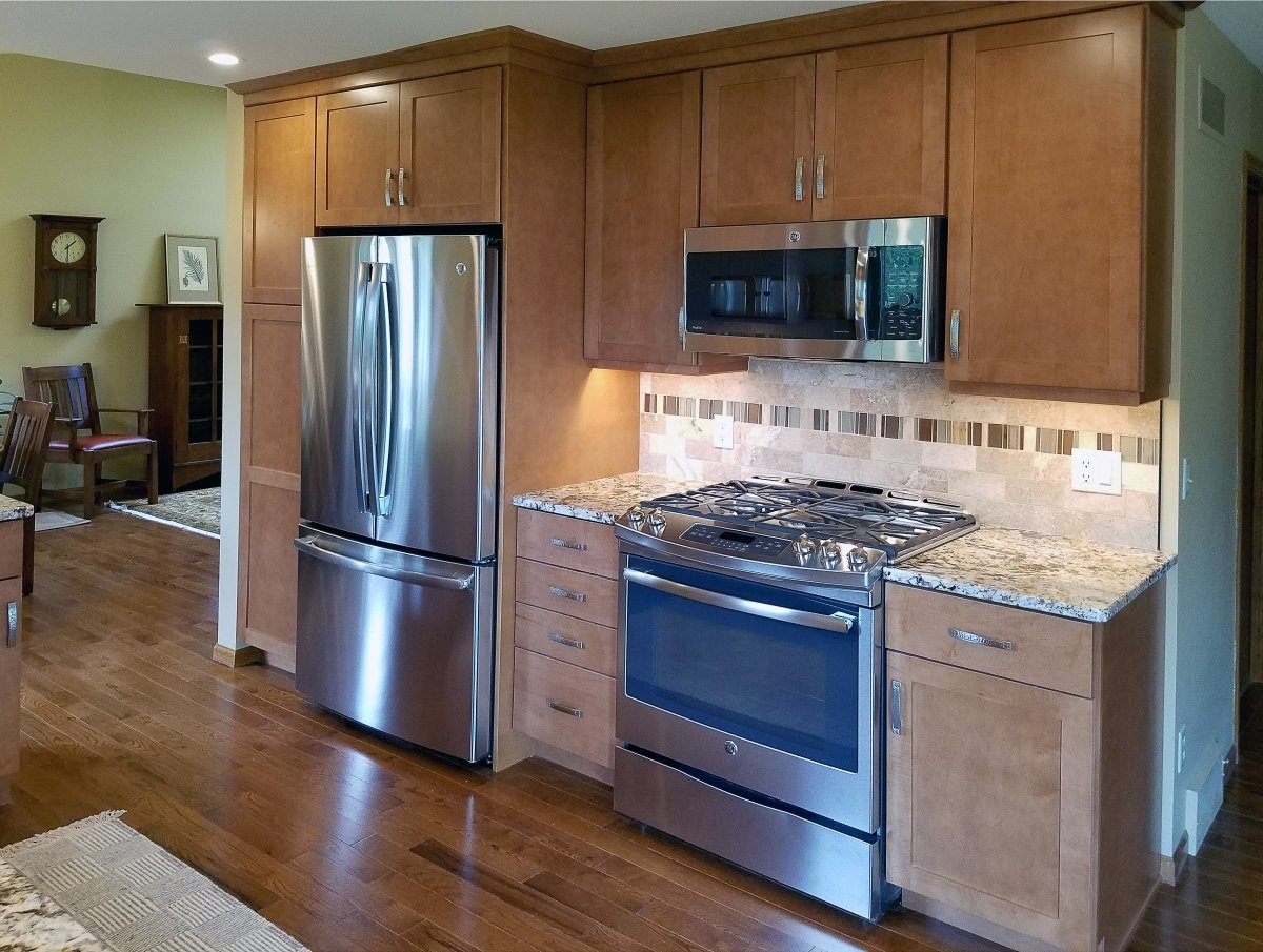 Kitchen Remodeling, medium brown kitchen cabinets, microwave above the stove