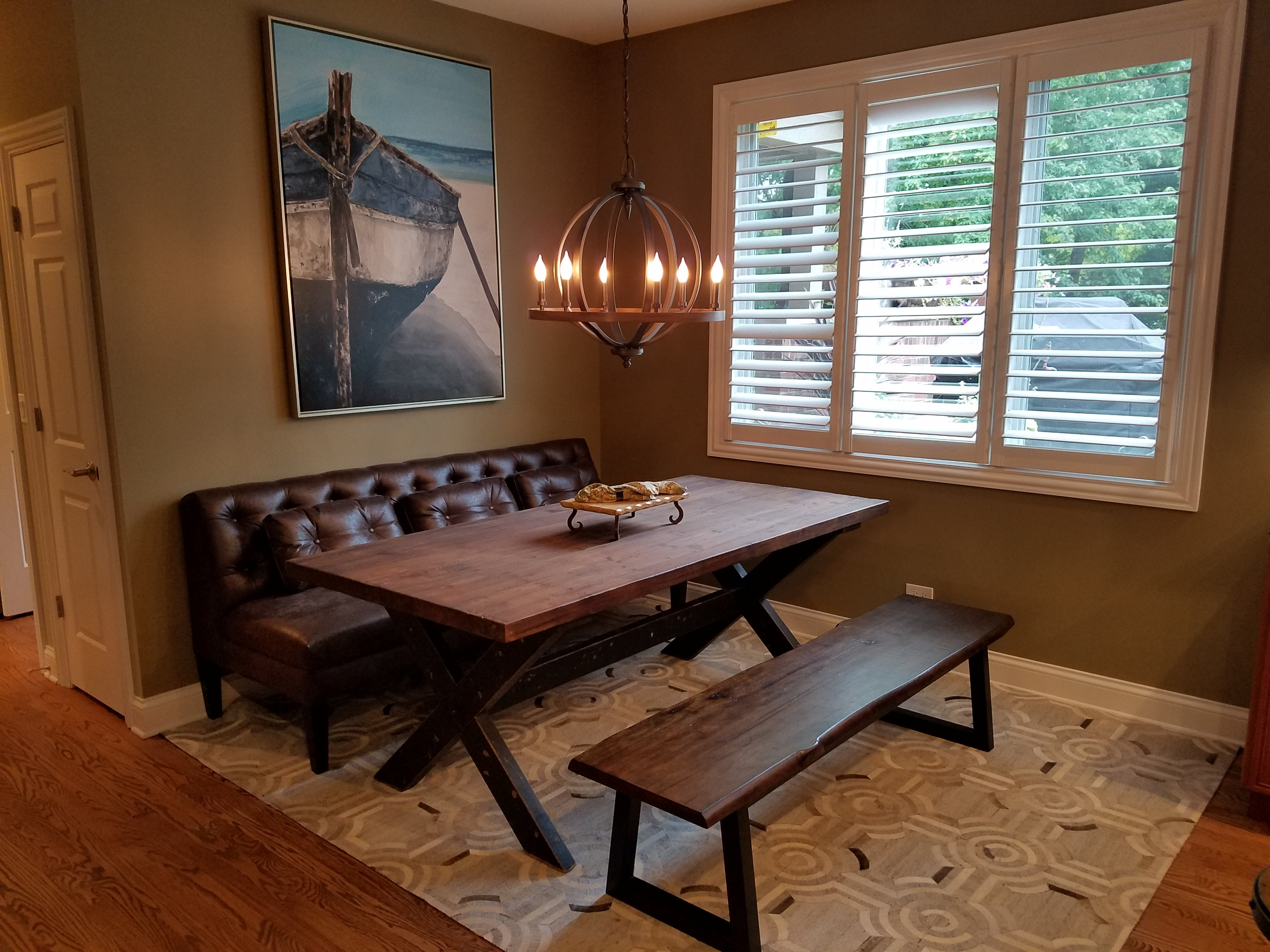 Kitchen Remodeling and Design, eat-in kitchen layout, dining bench with back, boat artwork, rustic chandelier, cowhide area rug, rustic kitchen table, olive green kitchen paint color, white wood shutters, white trim
