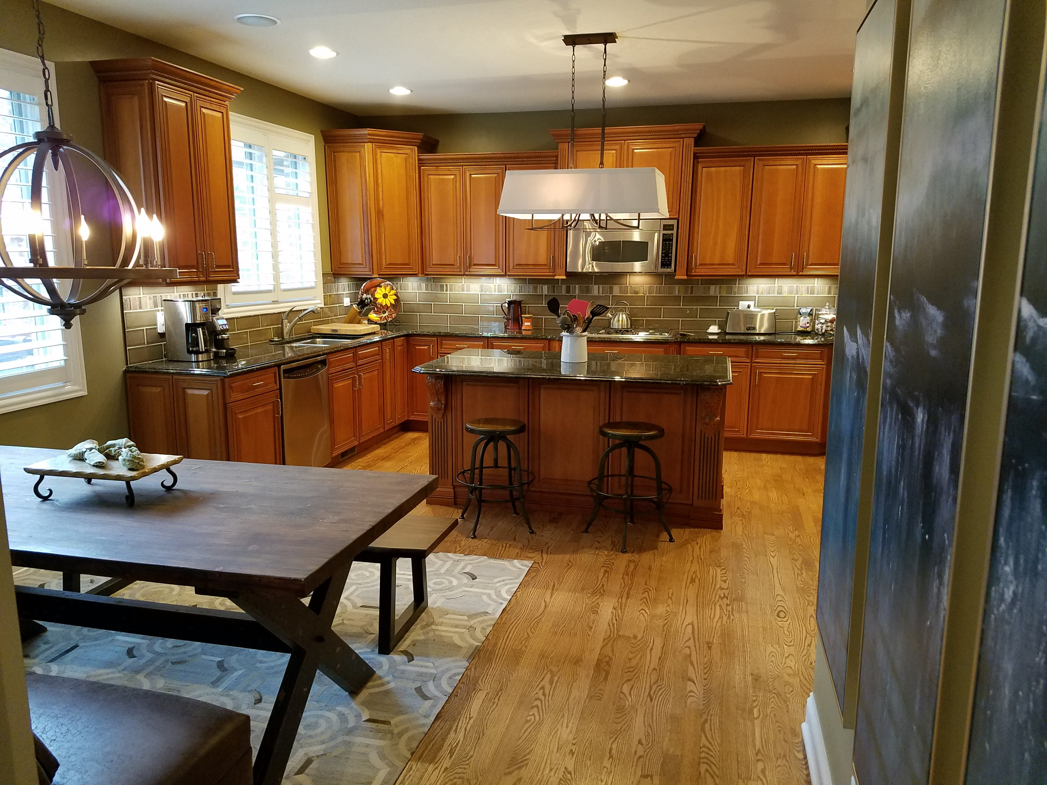 Kitchen Remodeling and Design, cherry kitchen cabinets, u-shape kitchen with an island, large pendant above the kitchen island, oak kitchen flooring