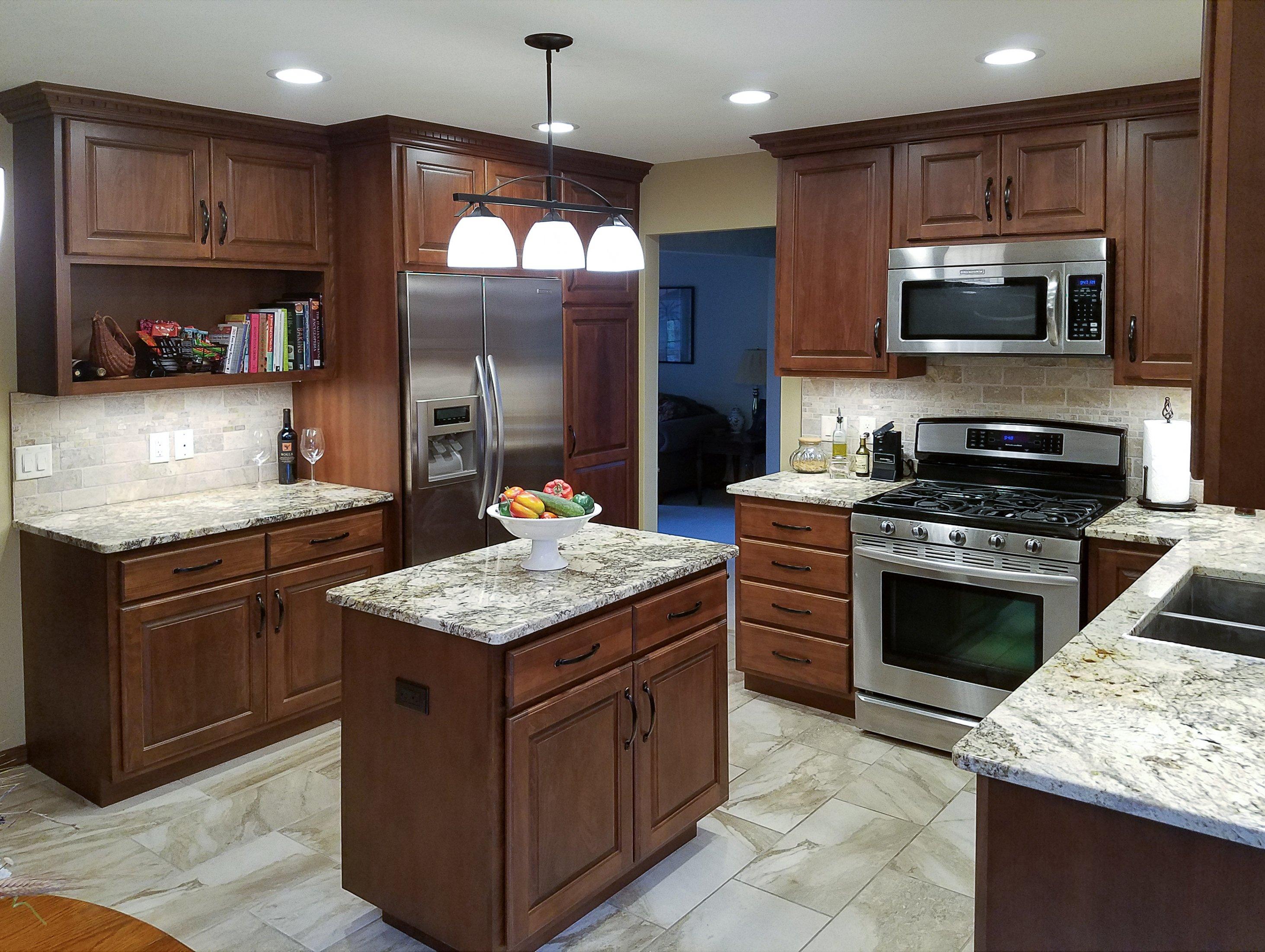 Kitchen Remodeling and Design, u-shape kitchen design, dark kitchen cabinets, light tile floor, small island