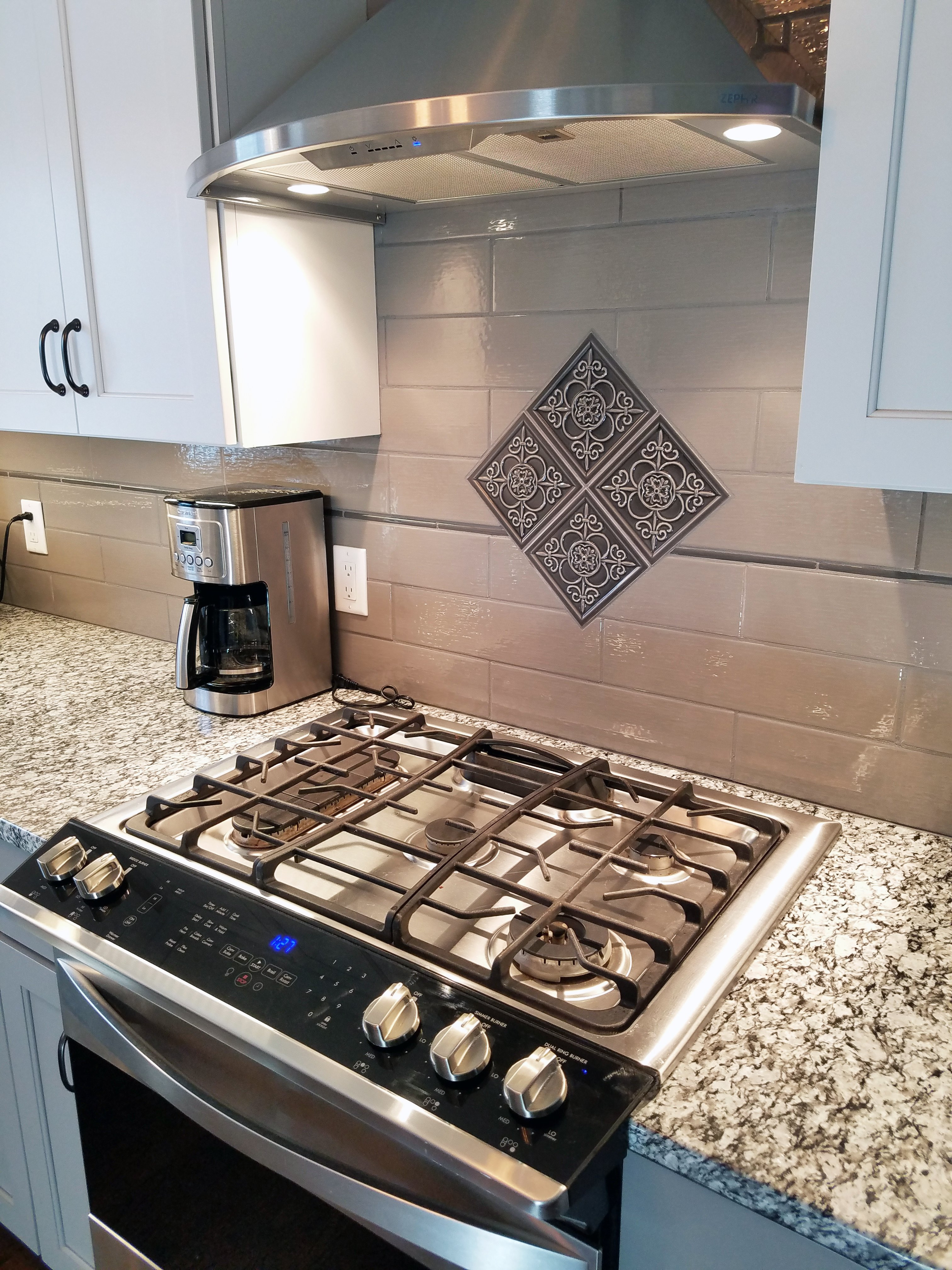 Kitchen Remodeling and Design, fleur de lis kitchen accent, medallion above the stove, gas stove,