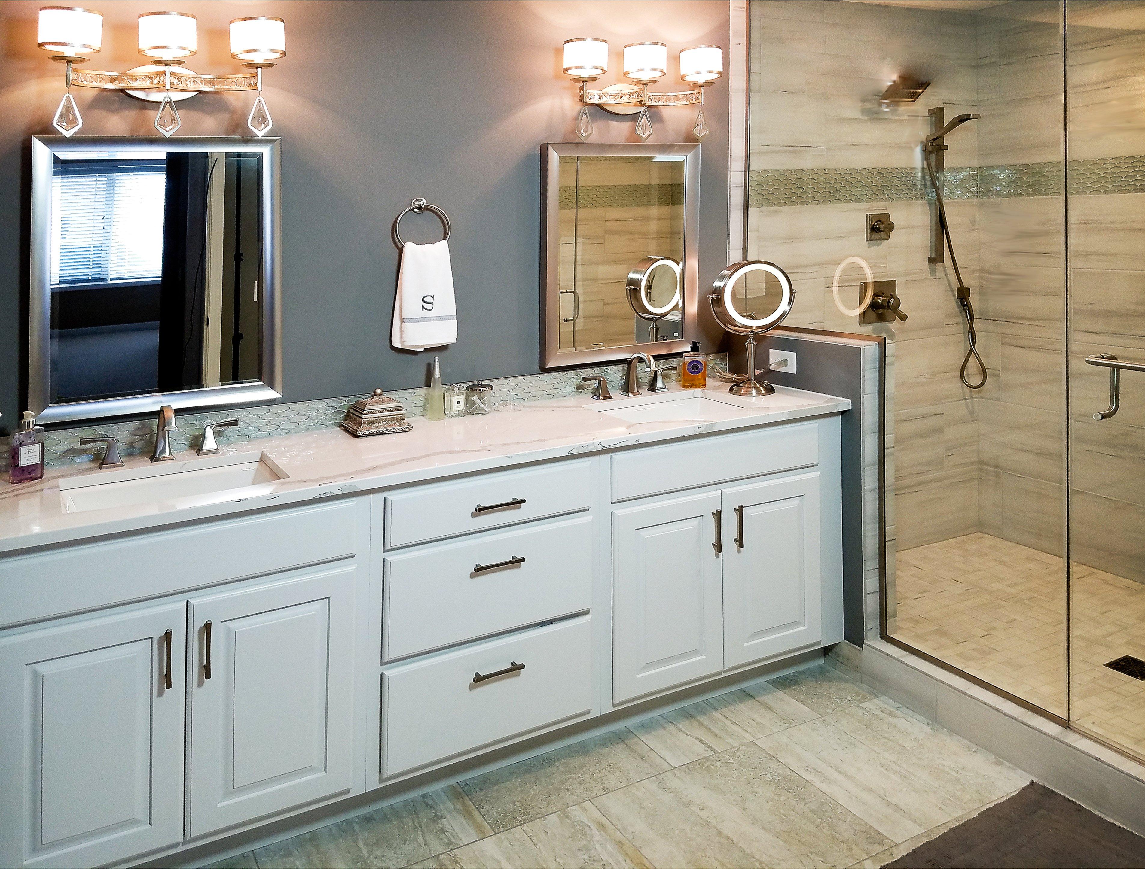 Bathroom Design, white vanity cabinet, raised panel vanity door, britannica cambria countertop, metal frame mirror,  Delta 3551LF-SS faucet