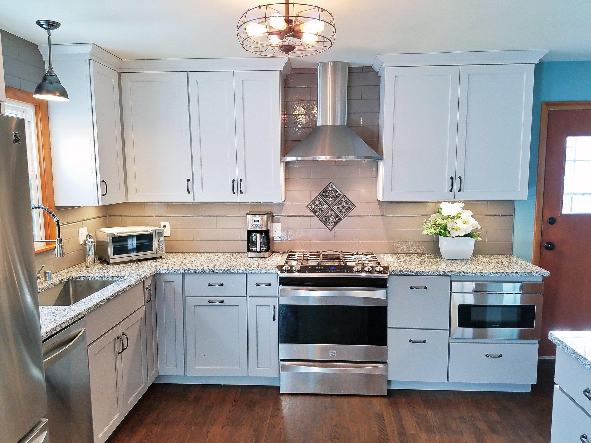 white cabinets, subway tile backsplash, kitchen, grey granite countertop