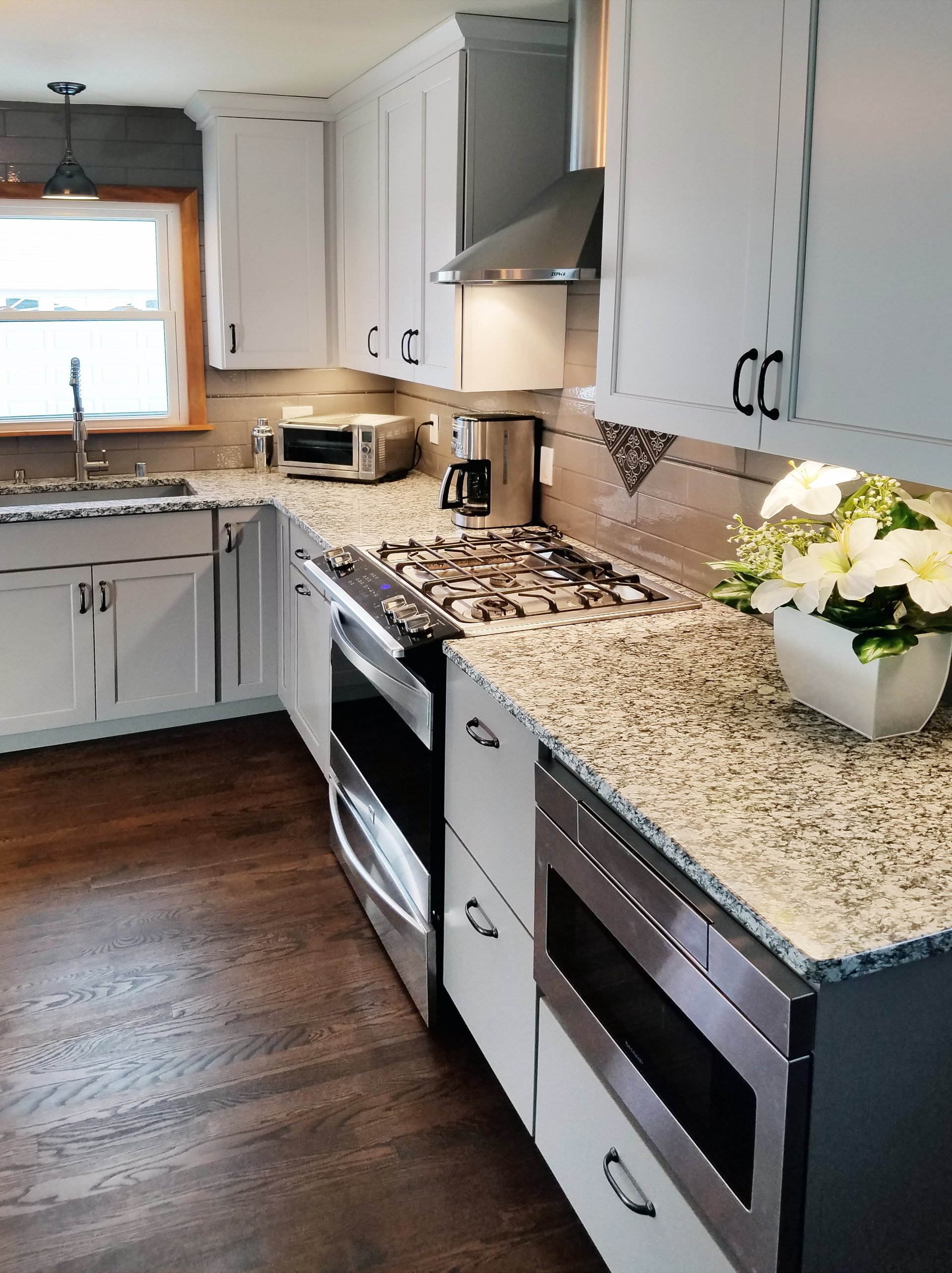 l-shape kitchen design, grey and white kitchen granite, microwave undercounter, stainless steel hood,