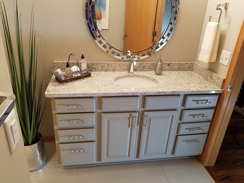 light grey vanity, single sink vanity, kohler round vanity sink, zgallerie Forza mirror