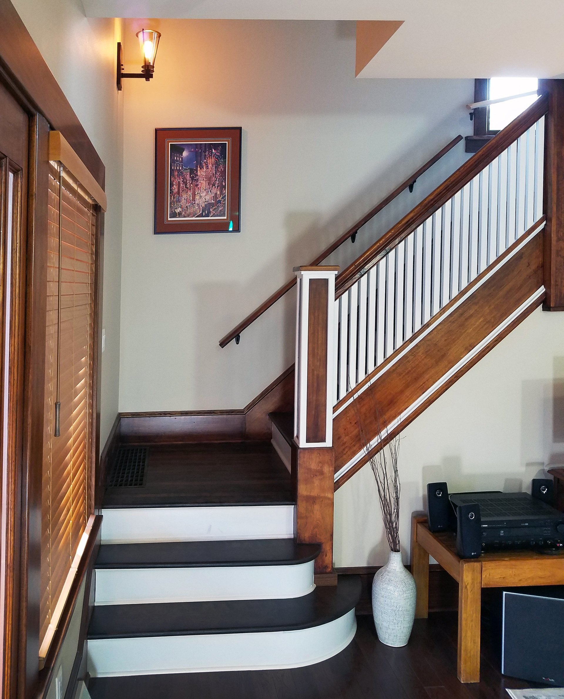 house remodel in Madison, WI, traditional staircase, craftsman staircase, two toned staircase, white riser staircase, white and wood staircase, white spindles and wood staircase,