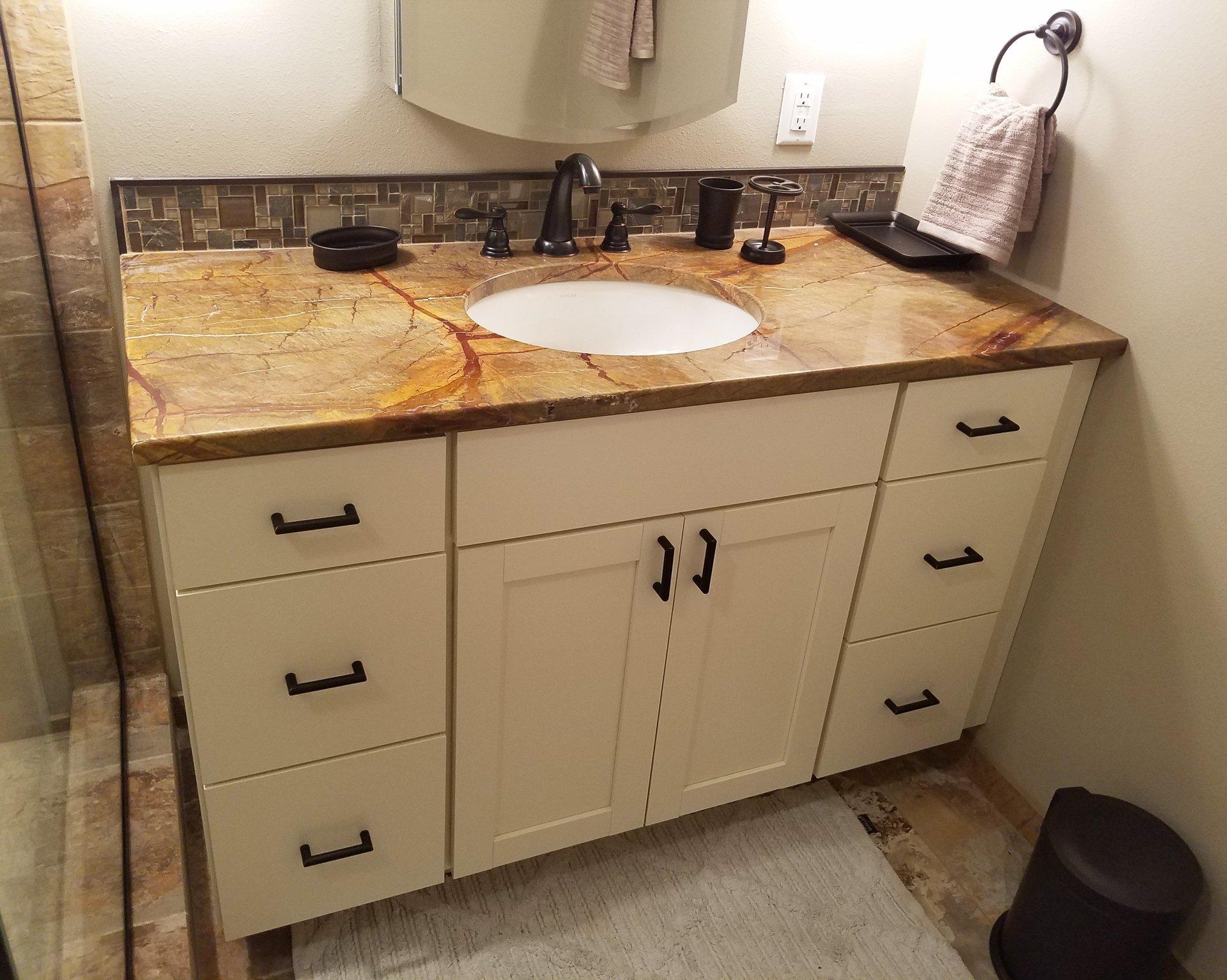 bathroom remodeling madison, wi, white vanity design, rainforest brown granite vanity countertop, tile splash around vanity
