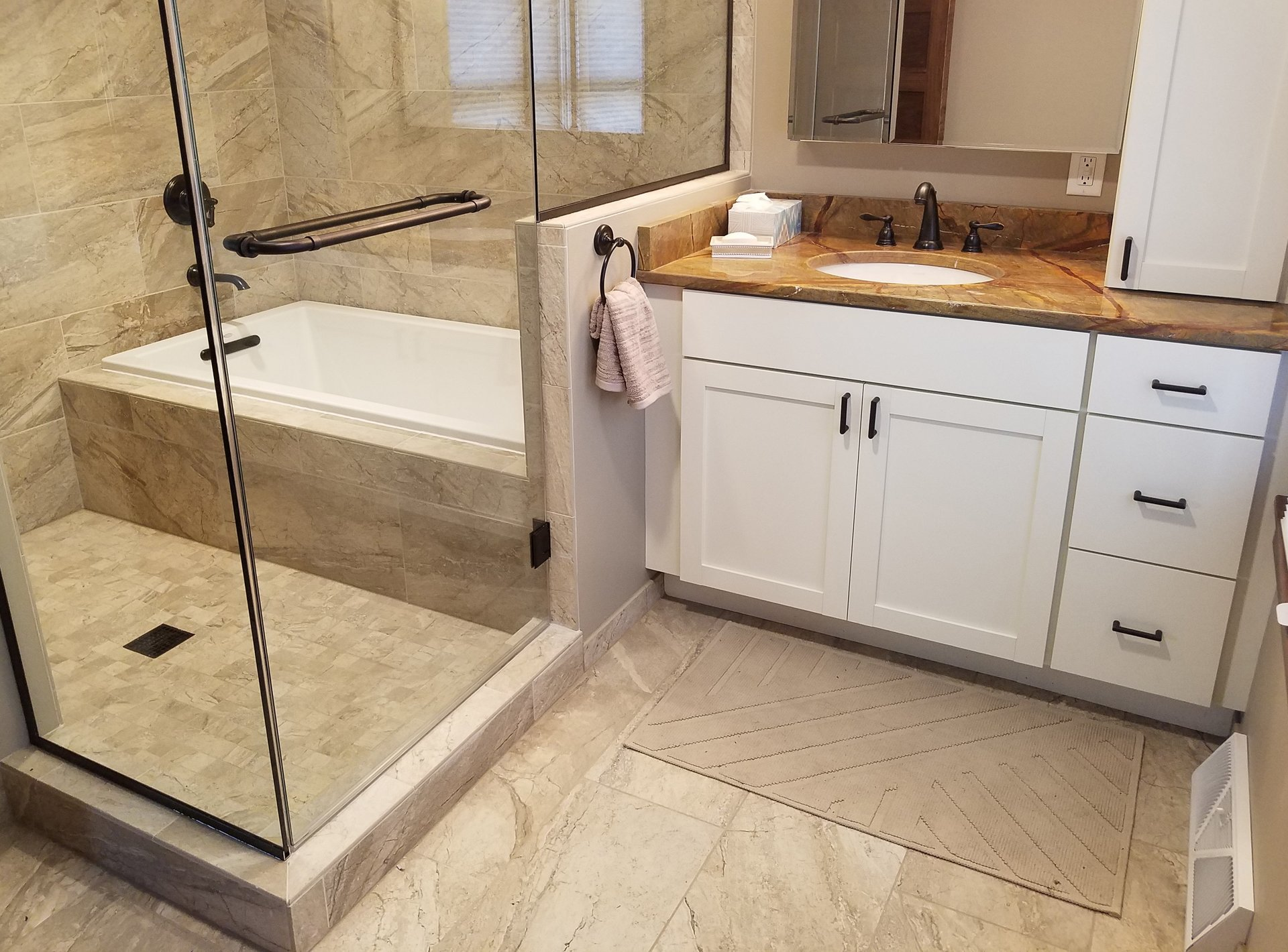 master bath remodel in madison, wi, beige bathroom tile, white shaker vanity, rainforest brown granite, frameless shower glass surround, tub and shower enclosure, separate tub and shower