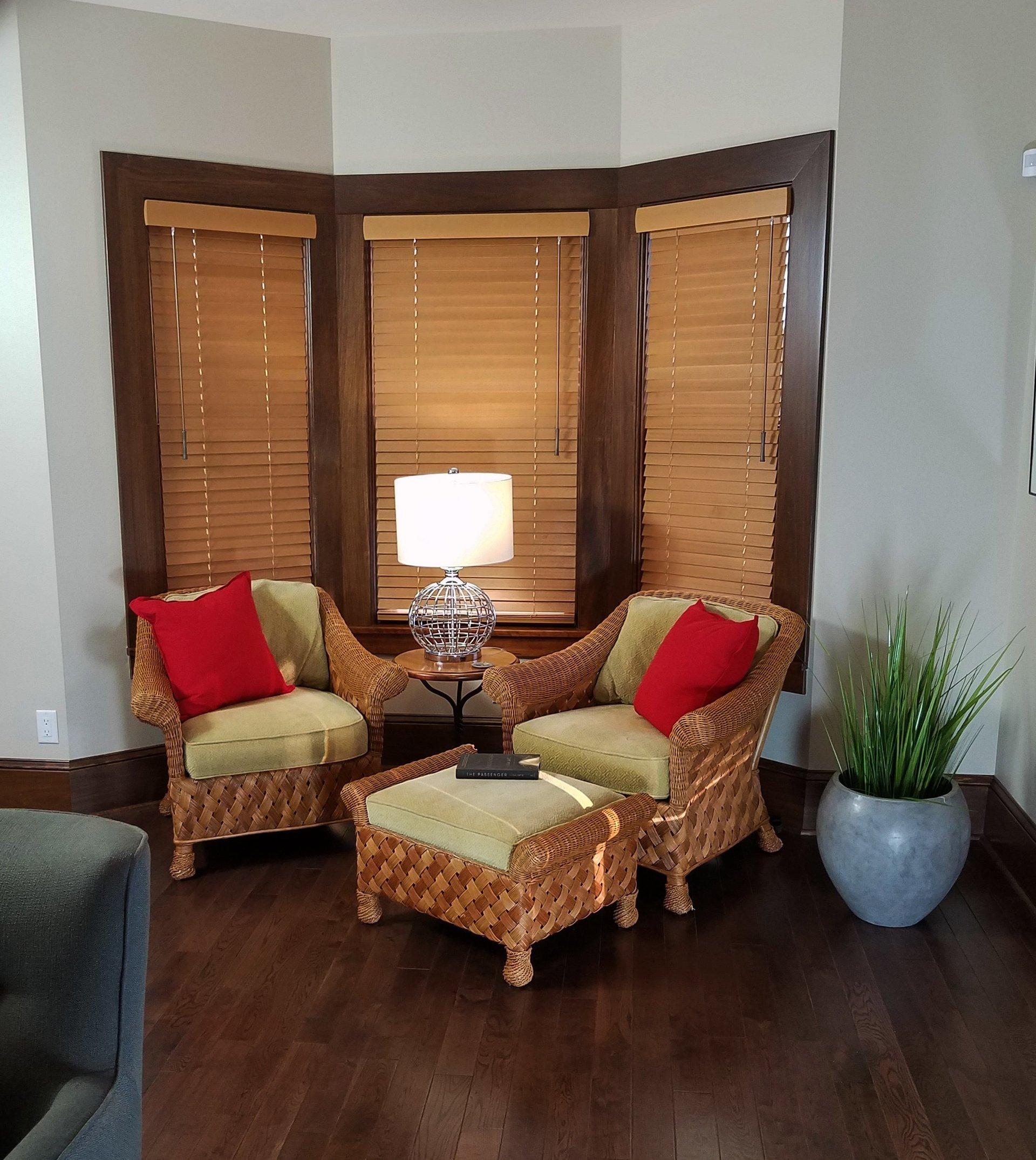 whole house remodel, madison WI, bay window, wood window casing, oak plank floor, red accent pillows