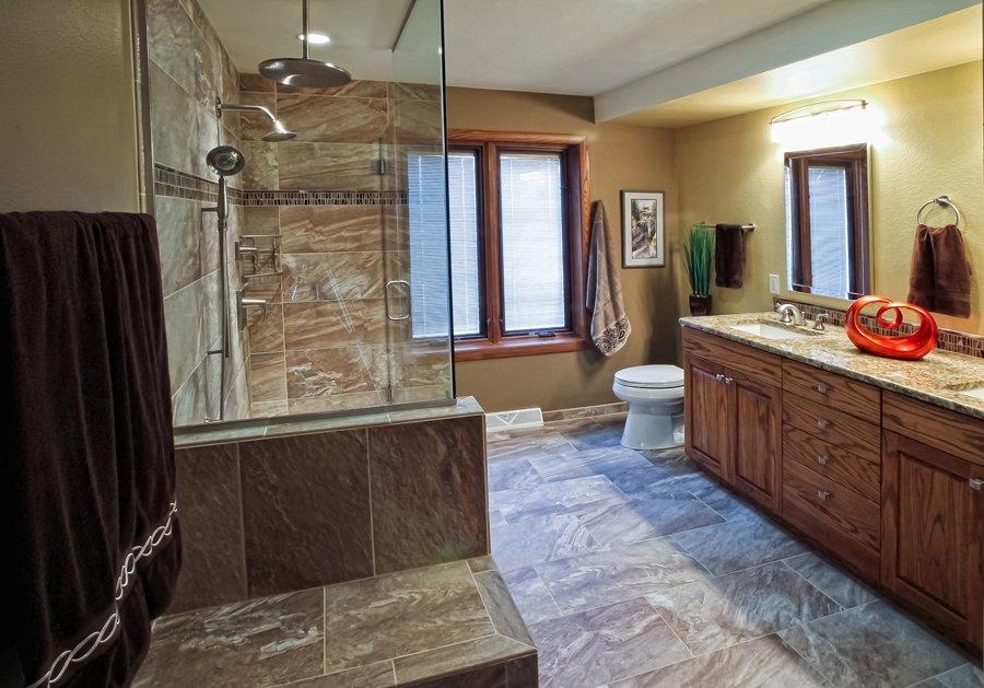 Bathroom Design, large bathroom design, frameless shower surround, rain shower head, onyx accent tile, built-in shower bench, large walk-in shower design,