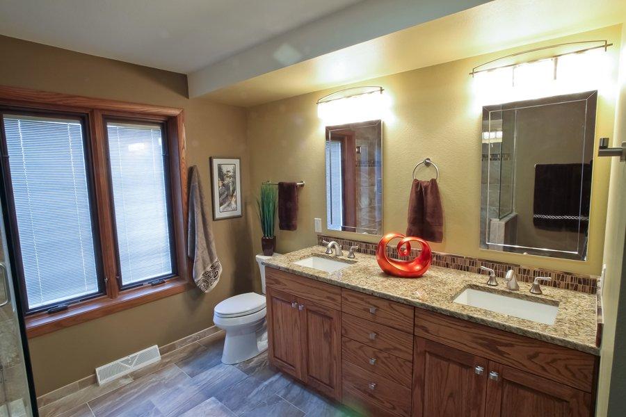 Bathroom Design, oak vanity cabinet, double sink cabinet, medium brown bathroom tile, rectangular vanity mirror, rectangular white vanity sink,