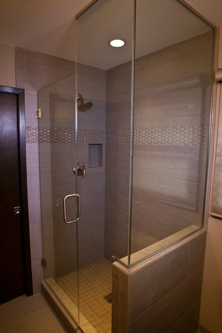 Bathroom Design, small shower design, pony shower wall, frameless shower glass surround, recessed can light in the shower