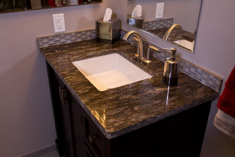 Bathroom Design, small vanity design, rectangular vanity sink, brushed nickel vanity sink faucet, basket weave accent glass tile, dark grey granite countertop