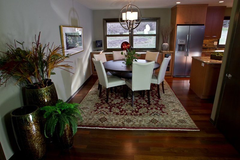 Kitchen Remodeling and Design, modern dining room , white dining room chairs, round chandelier, chandelier with white shades, traditional area rug in the dining room, round dining table