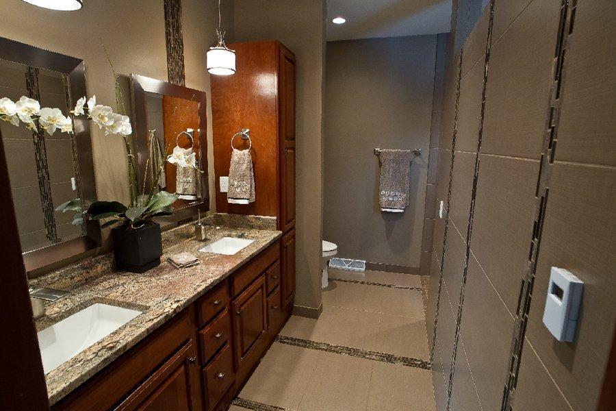 Bathroom Design, cherry vanity cabinets, double sink vanity, medium brown granite, taupe bathroom tile