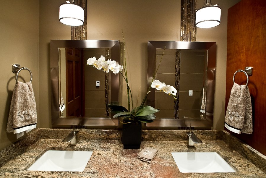 Bathroom Design,  double sink vanity cabinet, white kohler sink, brushed nickel mirror frame, glass accent tile, medium brown granite, brushed nickel bathroom fixtures, white pendants above sinks
