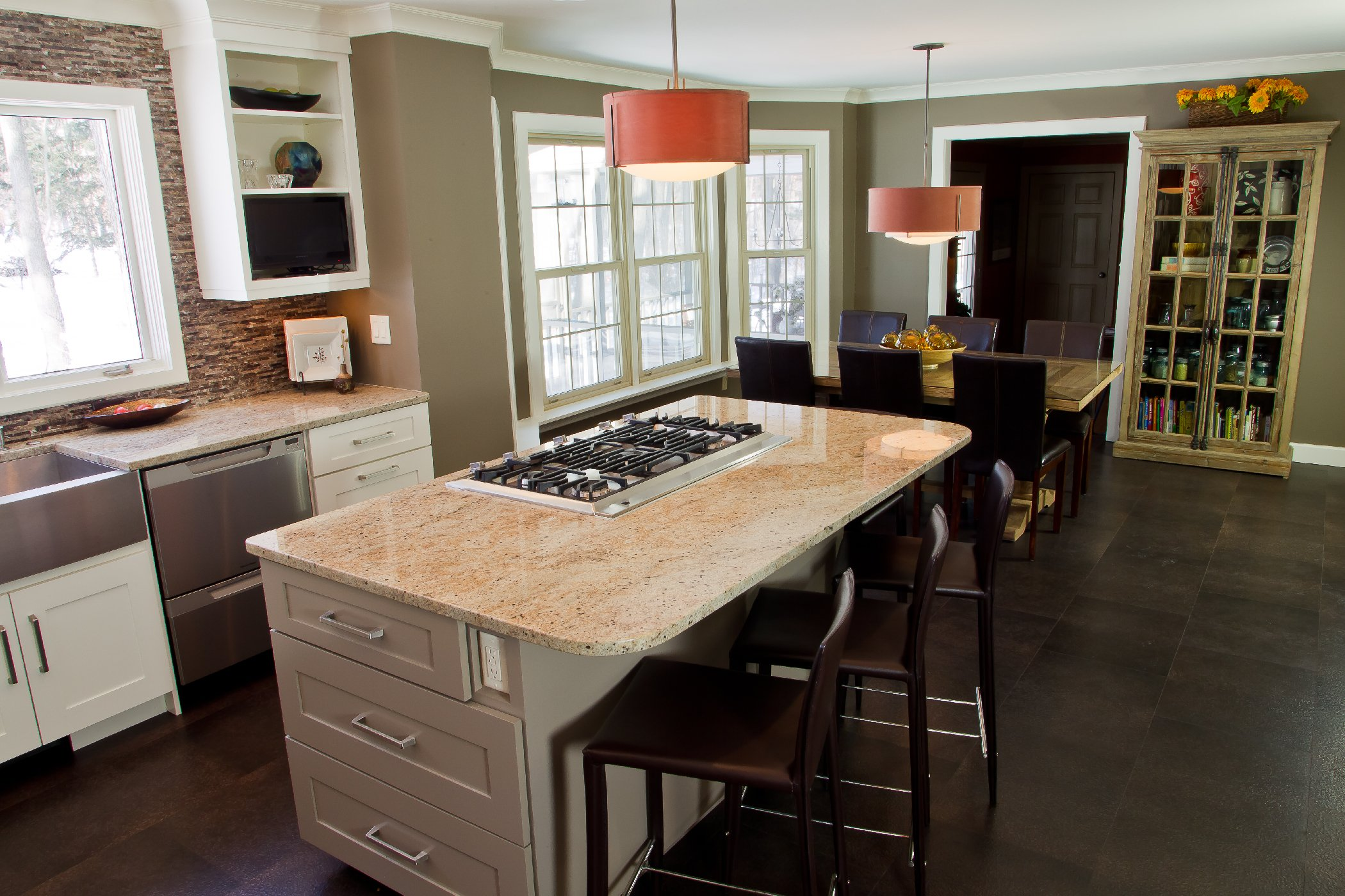 Kitchen Remodeling and Design, white kitchen design madison wi, orange and white granite, large kitchen island, shaker style kitchen cabinets, orange kitchen pendant, white trim, white crown molding, dark brown cork flooring,