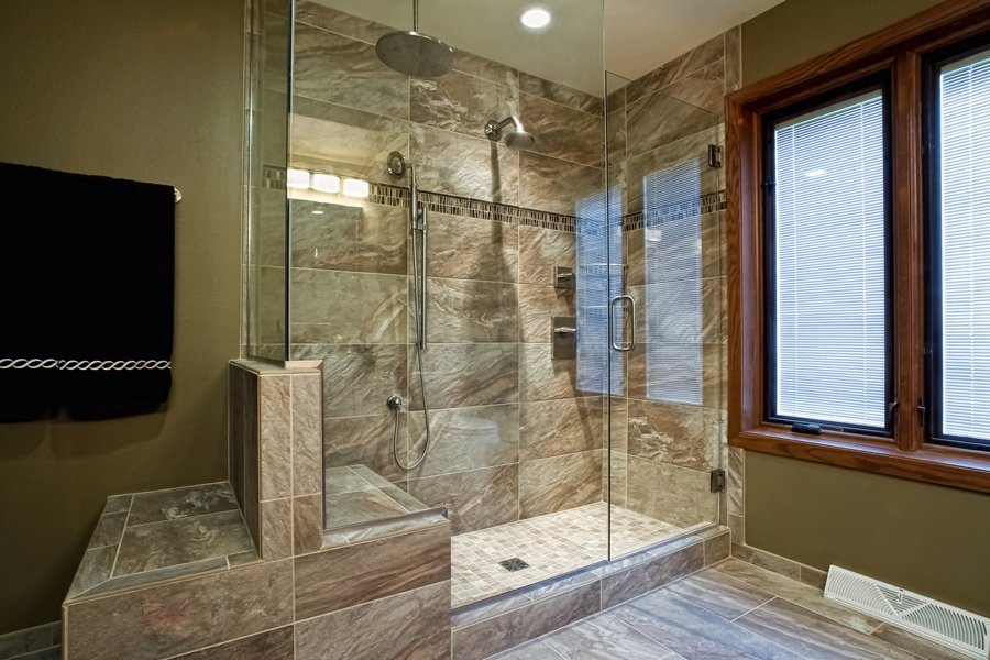 Bathroom Design, large walk-in shower, frameless shower glass surround, built-in shower bench, shower with a curb, brown shower tile