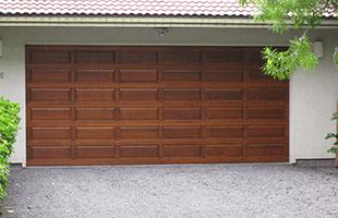 Replace or repair an inefficient overhead door. & Doorman-A Division of Black Coral Construction \u2013 Doors | Waikoloa HI