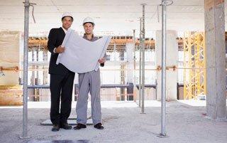 Men checking construction plan