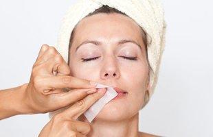 Waxing of woman upper lip