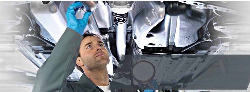 Mechanic checking car