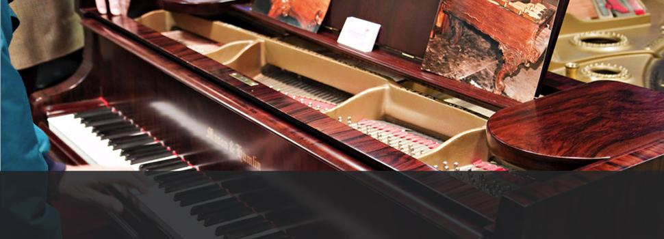Refirnished vintage black piano