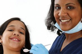 Dentist and patient looking at the mirror