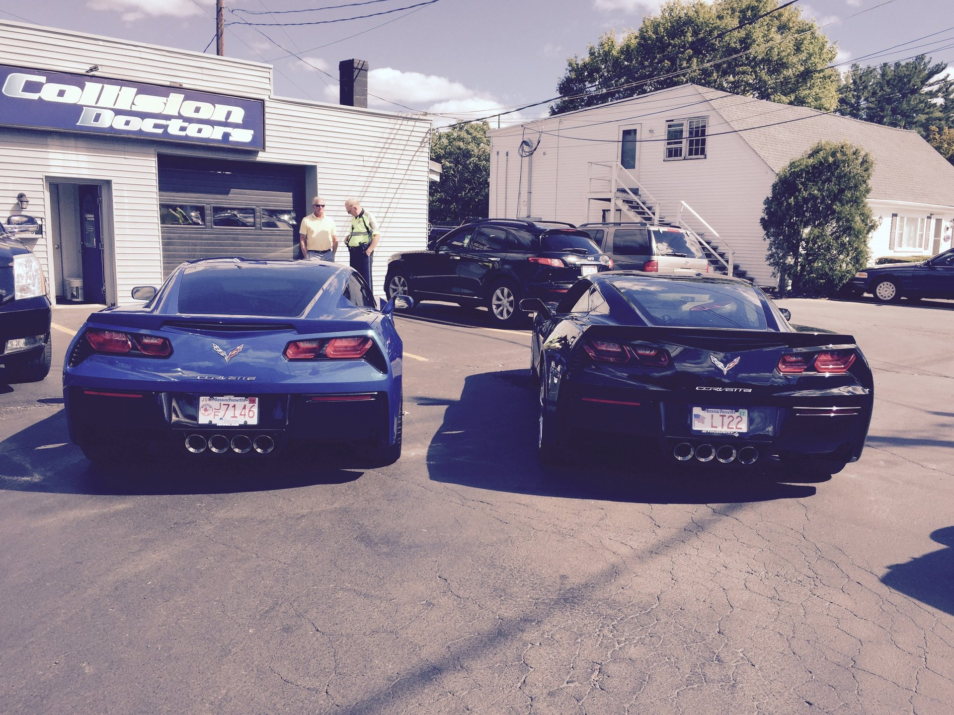 Two cars on repair shop