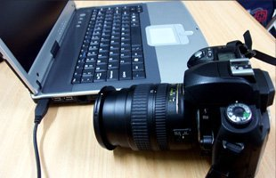 Laptop and DSLR camera on top of a table