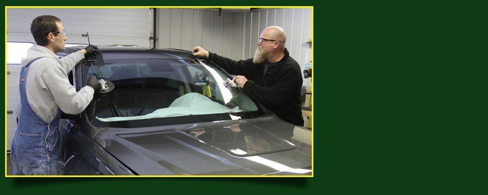 Workers installing the new windshield