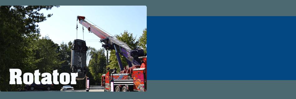 Rotator truck lifting a car