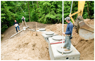 Crew installing a septic tank