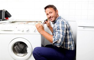 Happy man fixing washer
