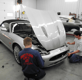 Employees fixing car | serving Marshall town and Marshall county