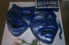 A cake with a theatrical theme