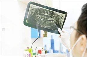 Dentist checking dental x-ray at the office