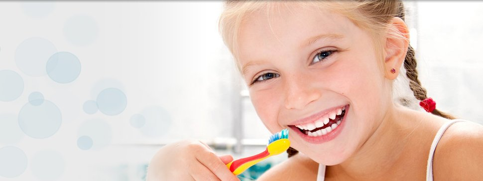 A child brushing her teeth