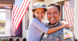 Happy military guy with child
