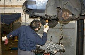 Technician inspecting transmission system