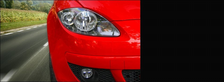 Close up view of the headlight of a red car