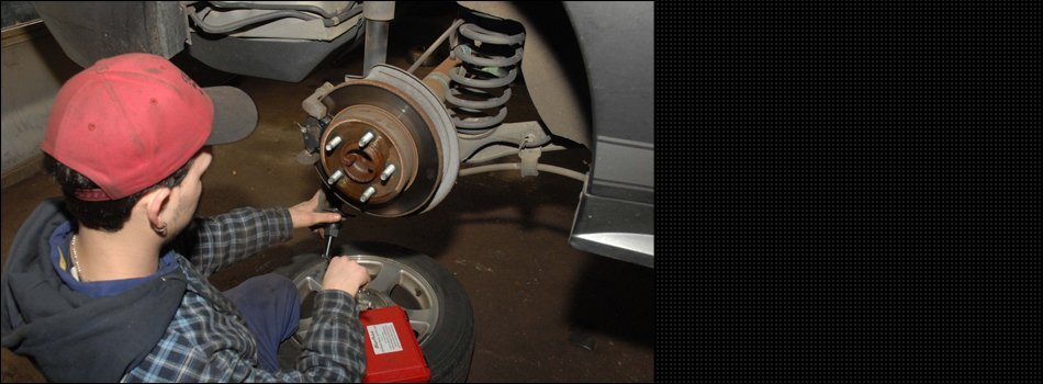 A worker working the wheel of the car