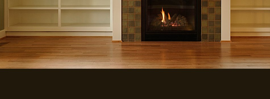 Hardwood flooring in front of fireplace