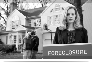 Woman holding a sign that says foreclosure