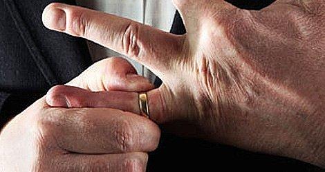 Man removing his wedding ring